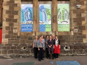 Attendees and Ailsa from RSH standing infront of the Rockfield Centre, Oban